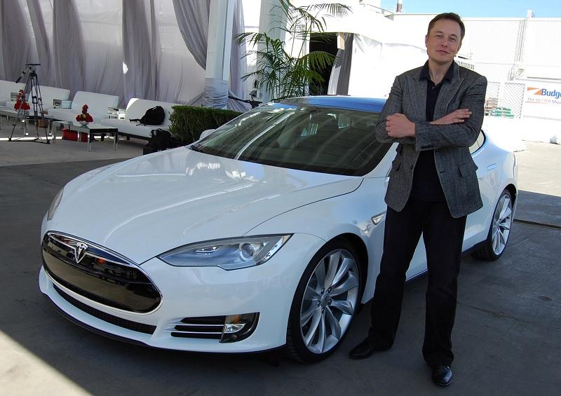 Elon Musk next to Tesla Model S